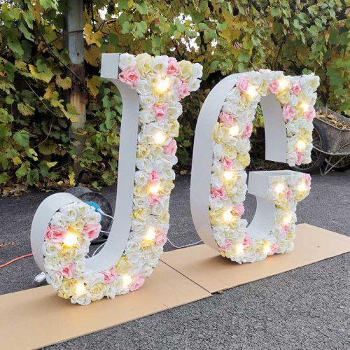Big floral letter with light for wedding